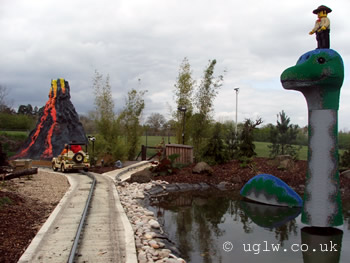 On-ride at the Dino Safari, you can see one of the jeeps on the track ahead